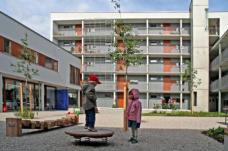 FrauenWohnen München-Riem, Innenhof Kinderspielbereich, Planung: Planungsgemeinschaft Zwischenräume München, Foto: FrauenWohnen eG