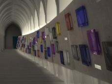 Spielerisch tänzelnd sind die Urnennischen in die Betonelemente gesetzt. Die Farben wurden im Laufe der Bearbeitung induvidualisiert.
